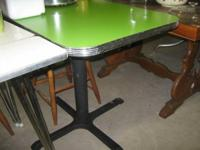 This is a well caf table with a metal pedestal and