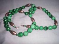 SELLING THIS BEAUTIFUL GREEN JADE NECKLACE, IT SCREWS