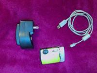 I'm selling my green digital camera, it takes