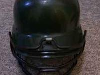 Green Rawlings baseball helmet with pony tail cut out.