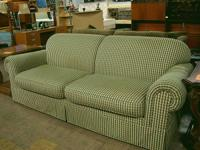 This charming checker plaid sofa is in excellent