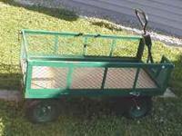 Green yard/wagon. 2 feet by 4 feet, very good tires,