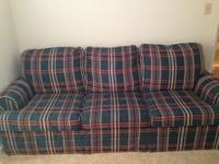 Green, plaid, hideabed sofa. Good condition. Minimal