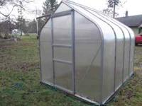 Nice aluminum framed greenhouse. Approximately