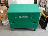 Greenlee 3660 slant top tool box with casters.