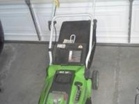 Rear discharge with bag. Includes strong battery and