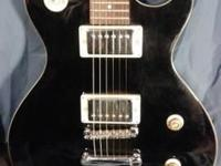 Black Electric Guitar with amp, case and stand. Good