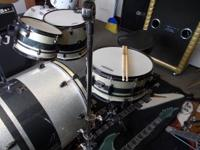 Very nice drum set looks and plays great please call me