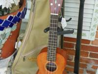List $440.00.   A medium-sized ukulele with a strong
