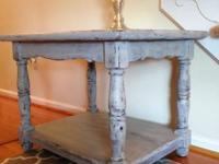 This stunning wood table with rounded legs and