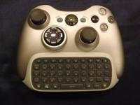 Silver or gray tinted wireless x-box 360 control with