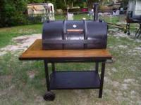 55 Gallon Drum grill. Has large grilling surface,
