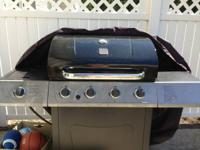 A Kenmore grill with 4 burners and a side burner, great