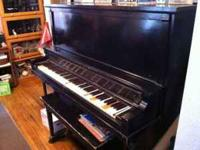 Older Grinnell Bros. Upright Piano. Good condition.