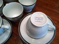 Collection of 8 white teacups (or coffee mugs) and