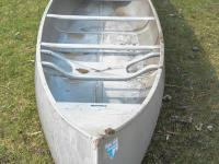 This is a 15-foot aluminum Grumman double-end canoe in