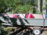 GRUMMAN FISHING BOAT WITH COX TRAILER.  THREE SWIVEL
