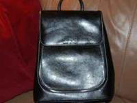 """I'm selling a black purse/backpack that says """"Gucci"""""""