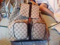 This is a real Gucci bag still with tags on it priced