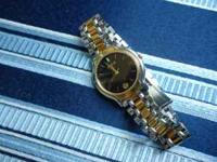 Gucci gold and silver 8000m wristwatch,watch is in