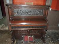 Right here for sale is a gorgeous antique pump organ in