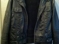 This is a beautiful black leather GUESS jacket I