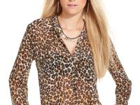 With allover leopard print, this GUESS blouse is