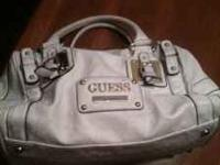 Quality guess leather purse. Nice weight to it and it