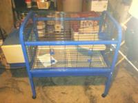 I currently have a guinea pig cage available. It is red