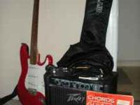 For sale is a Synsonic electric guitar, a Peavey Rage