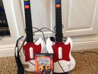 Guitar Hero III (Legends of Rock) for PS2. Two guitars