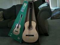 Guitar like NEW asking $75.00 OBO??? Serious callers