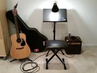 A Fender AC AG 20 acoustic guitar (well