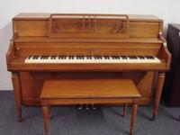This Gulbransen console piano in oak was built in 1955