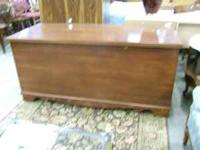 Looks like a blanket chest but has storage space for 3