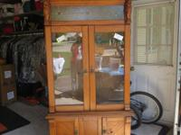 This old hand crafted gun cabinet is a must for your