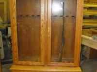 Up for sale is a solid oak gun cabinet. GUNS ARE NOT