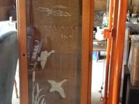 Etched glass gun cabinet. Good condition except no lock