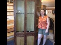 This gun cabinet is made out of mahogany and oak. The