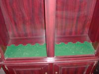 Very nice gun cabinet that holds 10 guns, green felt