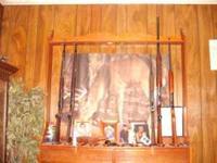 nice wood gun rack that hangs on the wall--very good