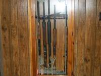 Wood gun cabinet - $50.00 OBO. Call  before 8pm.
