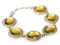 Opulent and fit for a queen, this magnificent bracelet