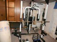 Gym set for sale. Includes weight stand with plates