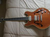 Two fine semi-hollow body acoustics. H.S. Anderson for