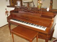 Beautiful upright piano and piano bench in excellent