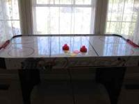I have a Halex Air Hockey table for sale. It is in