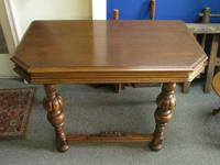 This antique fifty percent table is excellent for a