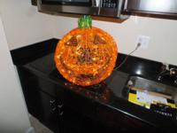 "Pumpkin lights up  and measures approximately 19"" x 15"""