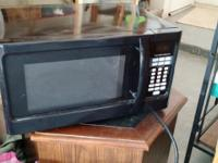 Black microwave. Works great. Little scratched. Selling